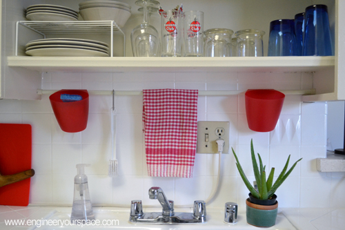 Small kitchen ideas tension rod above sink