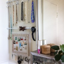 Bathroom-storage-with-tension-rod-side-view