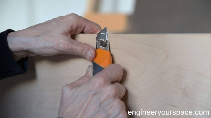 trimming-off-veneer-edging-Murphy-bed